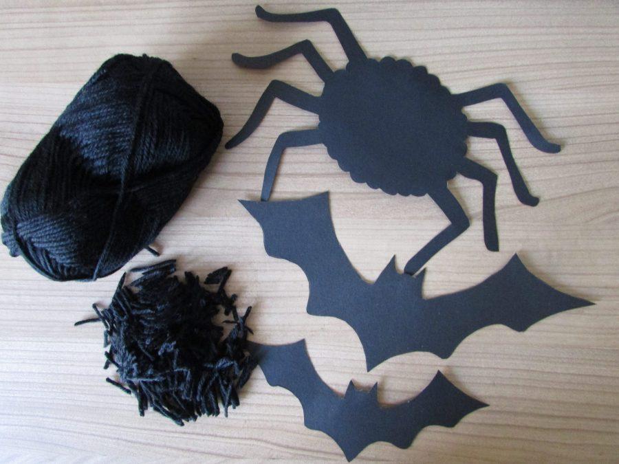 Arañas y murciélagos de Halloween con lana negra
